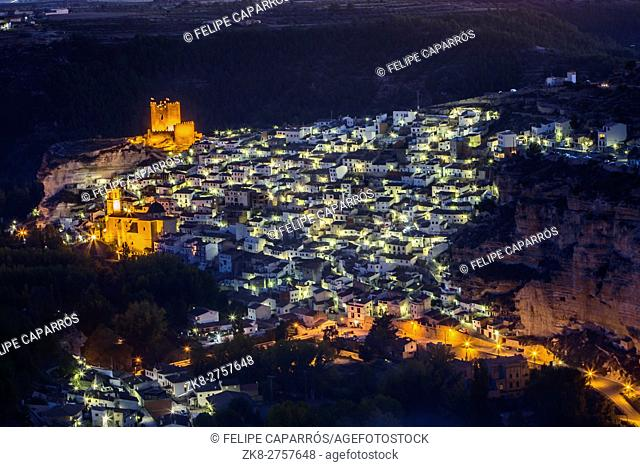 Night view of the city, on top of limestone mountain is situated Castle of the 12TH century Almohad origin, take in Alcala of the Jucar, Albacete province