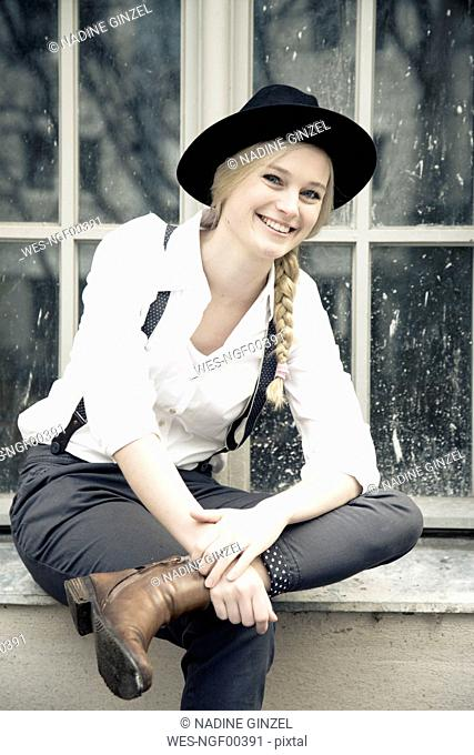 Portrait of smiling young woman wearing vintage clothing