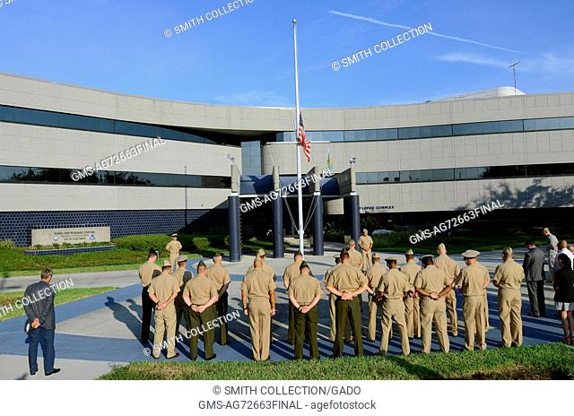 Marines, Sailors, and civilian employees observe a moment of silence at Naval Support Activity Orlando in honor of the five service members killed during a...
