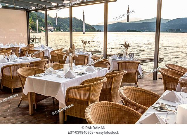 Luxurious restaurant with tables on pier at a Lake in Austria