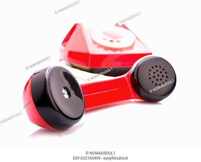 Macro of handset with red telephone on background