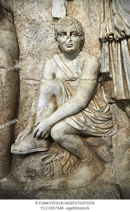 Close up of Roman Sebasteion relief sculpture of Meleager and Atalante Aphrodisias Museum, Aphrodisias, Turkey. . . Meleager sits on a rock tying his sandal
