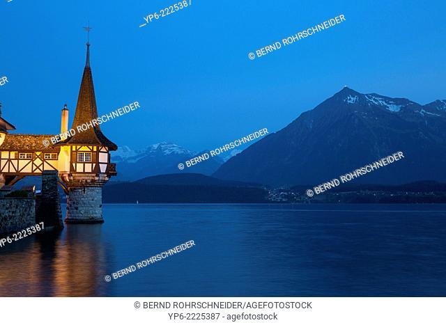 Oberhofen Castle at Lake Thun with mountains at night, Oberhofen, Switzerland