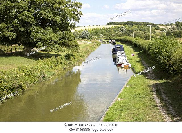 Narrowboats on the Kennet and Avon canal near Crofton, Wiltshire, England, UK