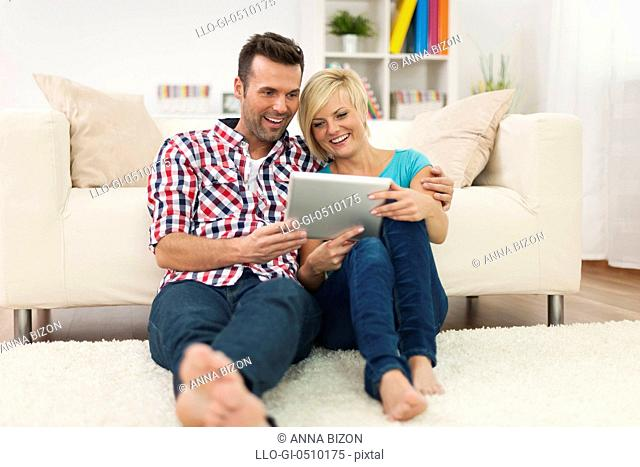 Beautiful couple at home with digital display. Debica, Poland