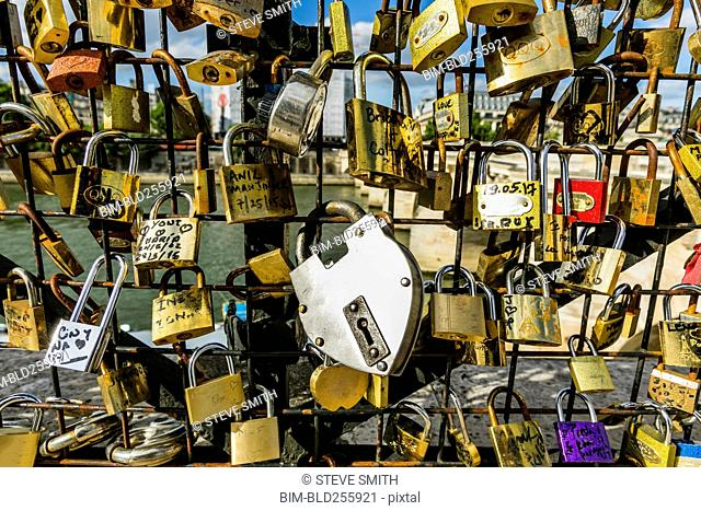 Padlocks on fence at river