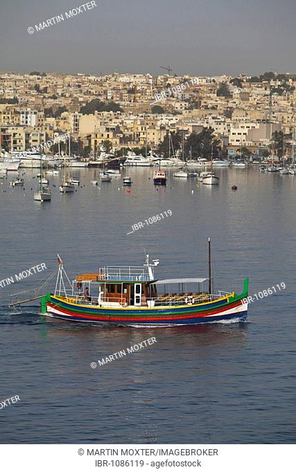 Typical Maltese fishing boat, in the back Manoel Island district, Valletta, Malta, Europe