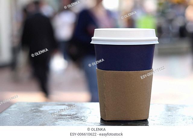 cap of coffee on a street