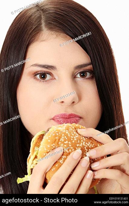 Beautiful caucasian woman eating hamburger