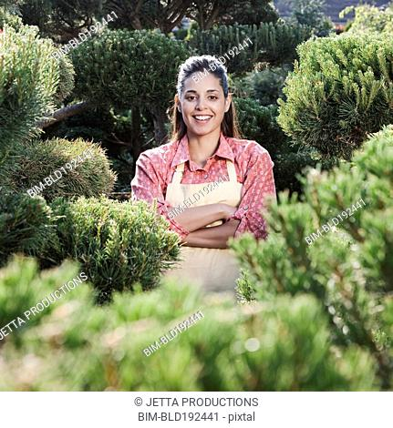 Mixed race woman working in garden nursery