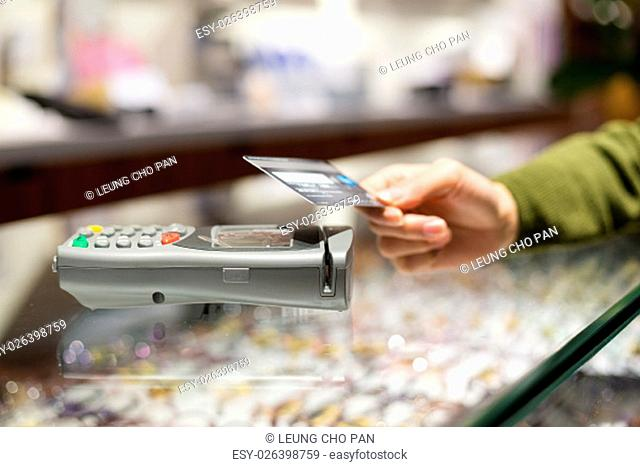 Woman pay by credit card with NFC