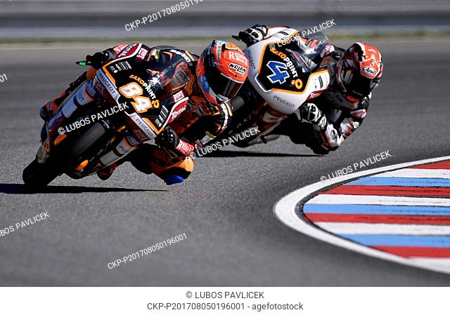 Motorcycle road racers L-R JAKUB KORNFEIL and PATRIK PULKKINEN in action during the Grand Prix of the Czech Republic 2017 on the Brno Circuit in Czech Republic