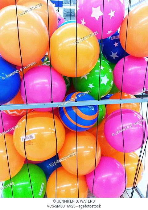 Colorful rubber beach balls for sale at a store