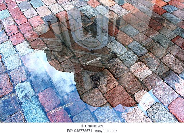 reflection of the cathedral in a puddle after rain in the medieval town of Tallinn, Estonia