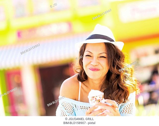 Chinese woman eating ice cream cone