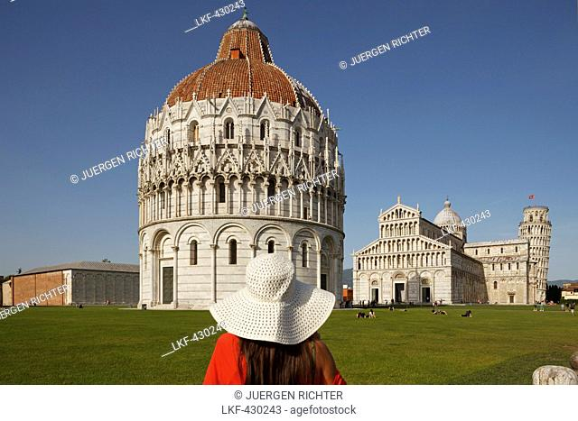 Woman admiring the Battistero, Baptistry, Duomo, cathedral, campanile, bell tower, Torre pendente, leaning tower, Piazza dei Miracoli, square of miracles