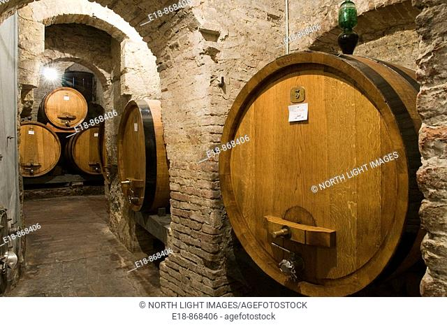 Italy, Tuscany, Montepulciano.  Barrels of wine ageing in the cellar of winery