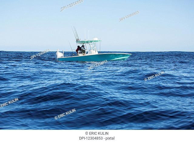 Fishing from a boat on the Atlantic ocean; Cape Cod, Massachusetts, United States of America