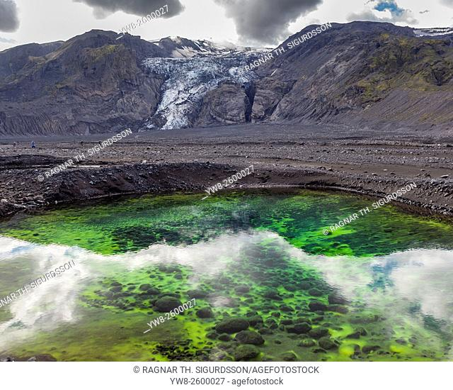 Algae and ash in ponds by Gigjokull- outlet glacier from Eyjafjallajokull Ice Cap. Months after the Eyjafjallajokull eruption the landscape is transformed