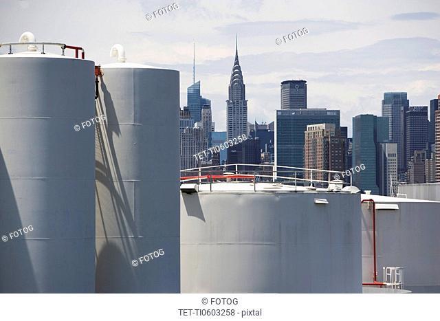 USA, New York, Industrial area and city skyline