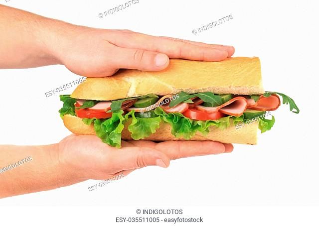 Half of french baguette sandwich in hand. Isolated on a white background
