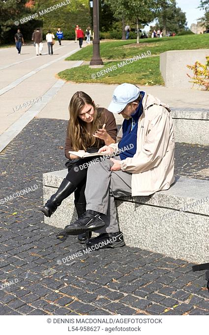 Teacher and Student on Bench Cornell University Campus Ithaca New York Finger Lakes Region