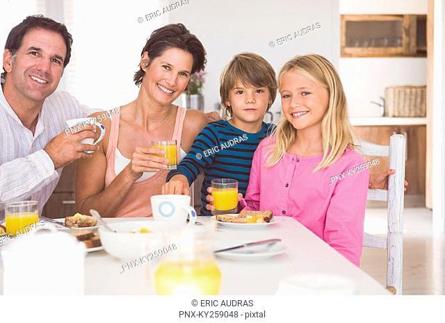 Portrait of a family having breakfast
