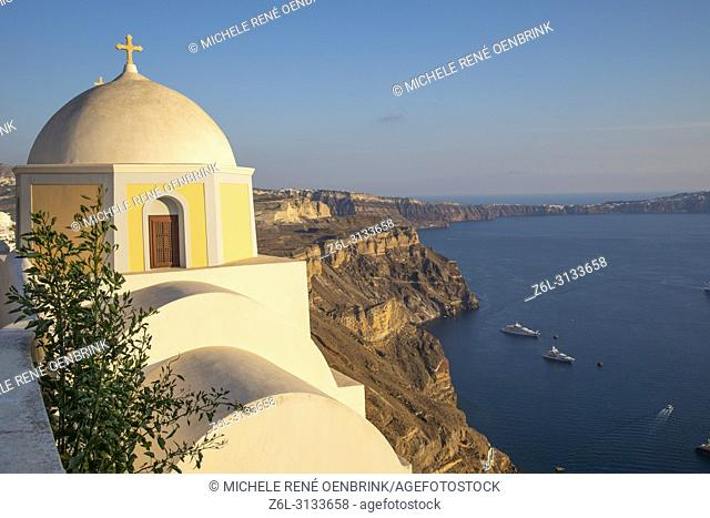 Domed church with steeple in town of Fira, Santorini Greece