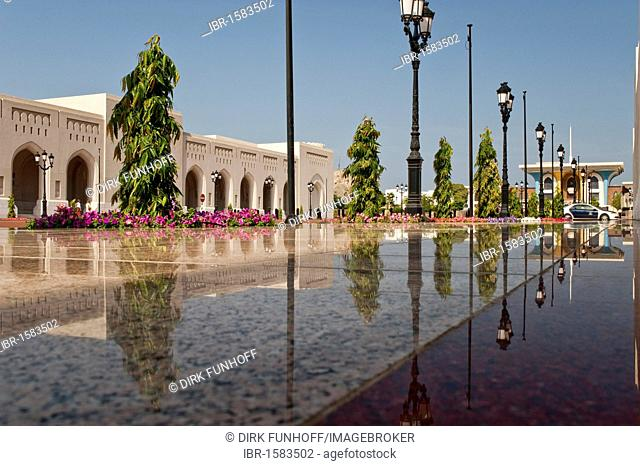 Main building of the Al Alam Palace, with reflection on the shiny polished tiles of the entranceway, Muscat, Oman, Middle East
