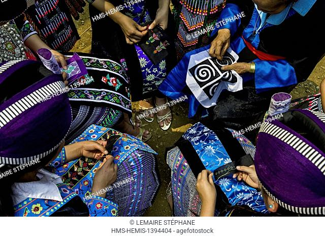 Laos, Luang Prabang province, Na Wan, ethnic group Hmong, session of sewing of the teenagers Hmong with their grand mother