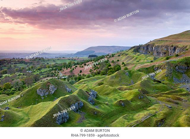 Sunrise over the abandoned quarry workings on the Llangattock Escarpment, Brecon Beacons National Park, Powys, Wales, United Kingdom, Europe