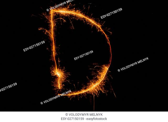The English letter D made of sparklers on black background