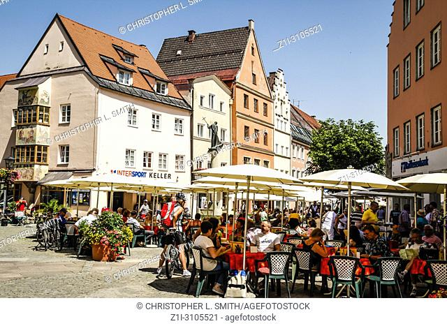 People in the downtown shopping district of Fussen in Southern Germany