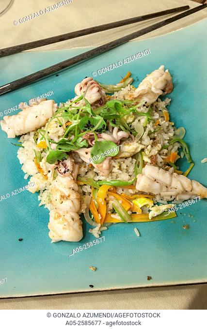 Sauteed squid with fried rice vegetables. Lounge River Restaurant. Hoi An. Centre of Vietnam. Asia
