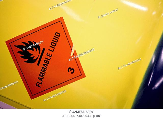 Fabric coating plant, flammable warning label on side of metal drum