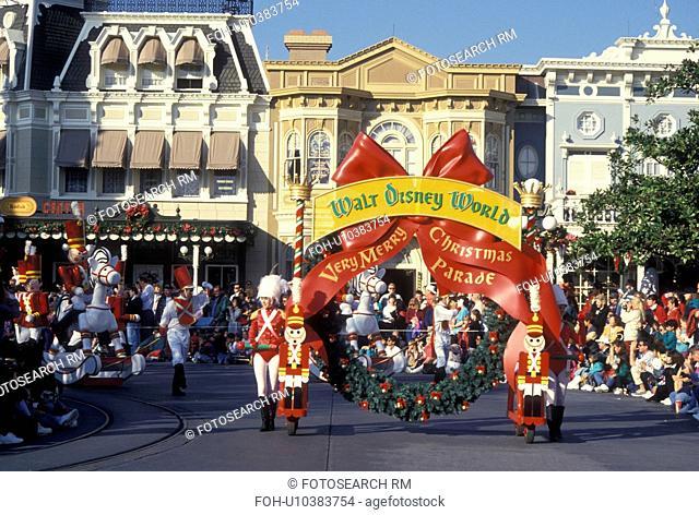 parade, Disney World, Orlando, Magic Kingdom, FL, Lake Buena Vista, Florida, Crowds line Main Street U.S.A. for A Very Merry Christmas Parade during the...