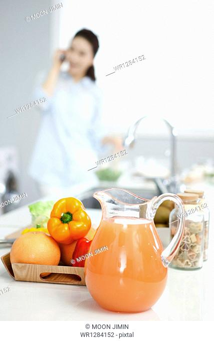 a woman talking on the phone while cooking