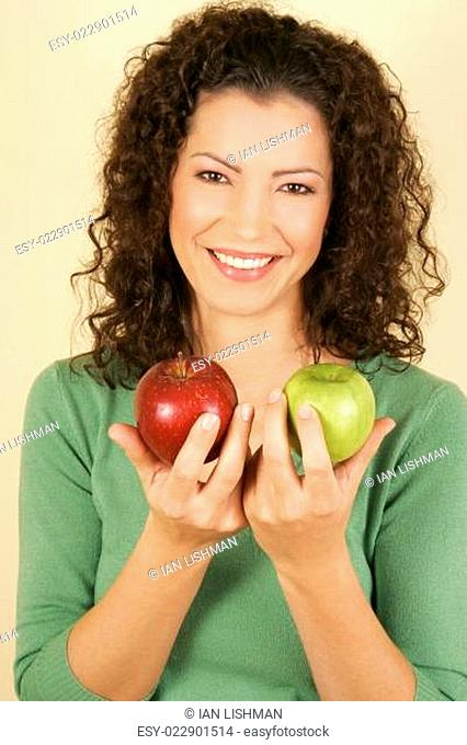 A woman holding two apples