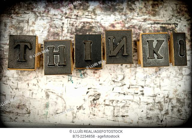 Think. Writen with several tipes from a rubber stamps alphabet