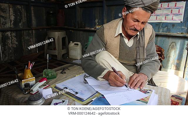 Afghan lawyer talks to clients, Kunduz, Afghanistan