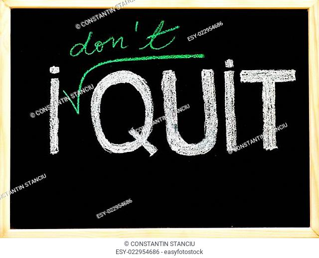 I don't quit message, handwriting with chalk on wooden frame blackboard, lifestyle change concept