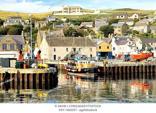 The fishing harbour and old town of Stromness, Mainland, Orkney, Scotland, UK  Summer