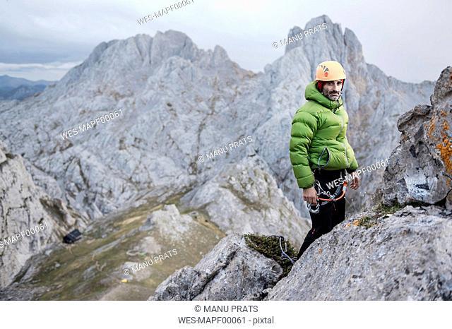 Spain, Picos de Europa, climber standing on rock
