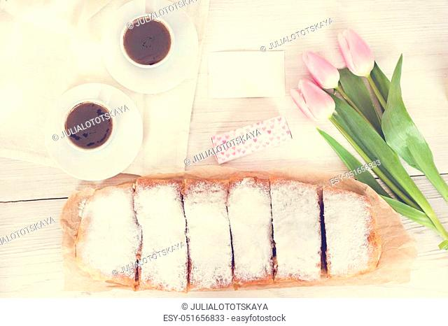 Strudel or pie and a spring decoration on a white background