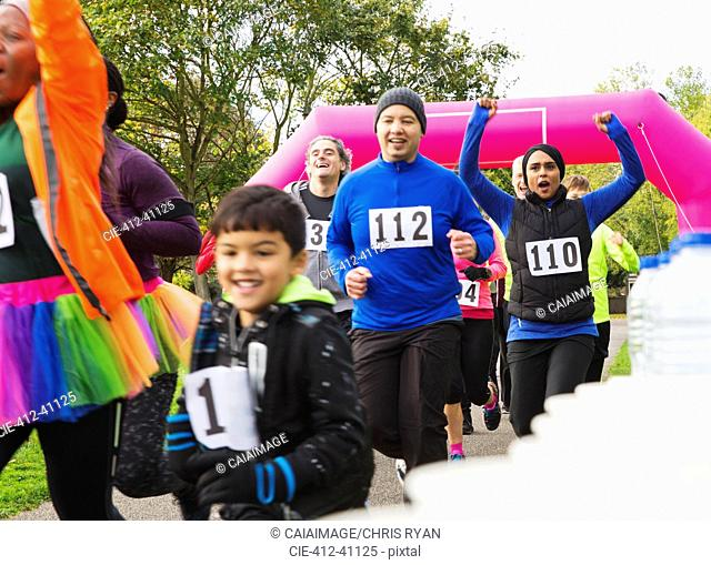 Enthusiastic runners running at charity run in park