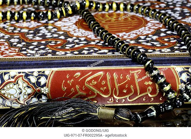 Holy Quran and muslim prayer beads