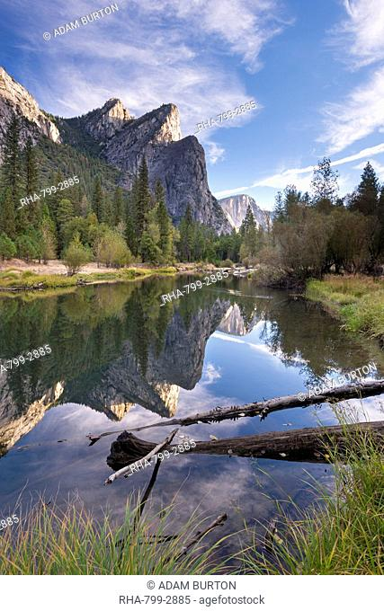 The Three Brothers mountains reflected in the tranquil waters of the River Merced, Yosemite National Park, UNESCO World Heritage Site, California