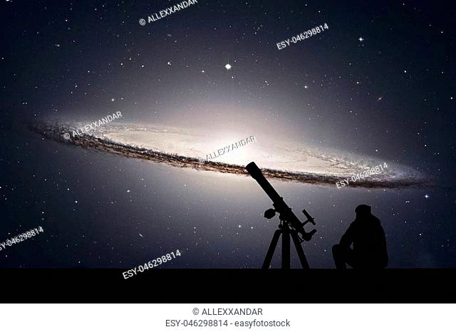 Man with telescope looking at the stars. Sombrero Galaxy M104 in constellation Virgo.Elements of this image are furnished by NASA
