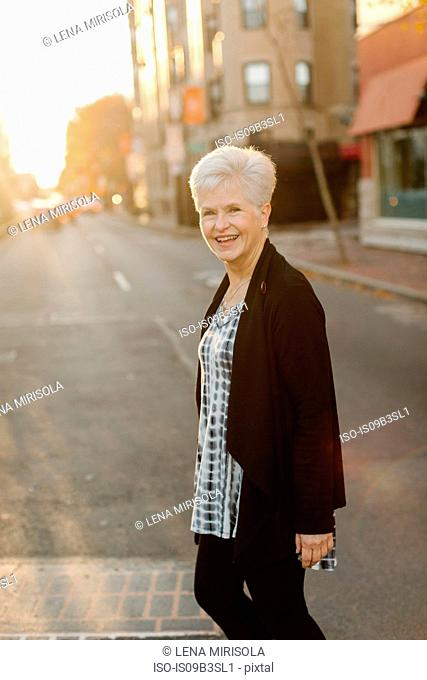 Portrait of senior woman, outdoors, smiling