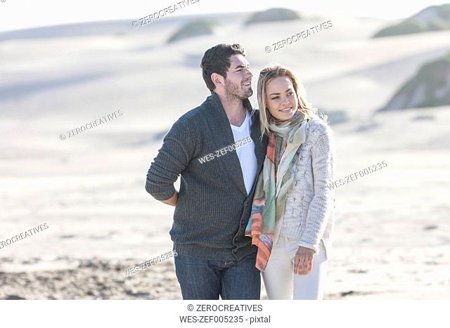 South Africa, Cape Town, young couple walking on the beach